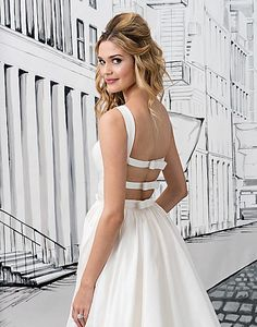 Simplicity at its best is created by this Silk Dupion ball gown with a Sabrina neckline, natural waist, open back with bow closures, and cathedral length train.
