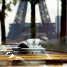 read a book and drink coffee in Paris with the view of the Eiffel tower in sight! amazing