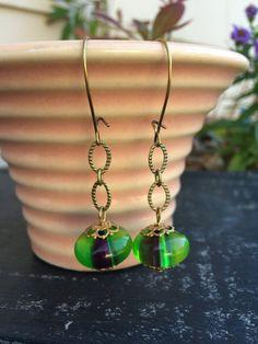 Lovely green, purple, off while vintage glass drop earrings.  Tilliegirlstudio