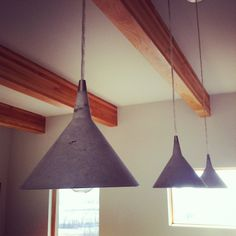 Concrete martini pendants.