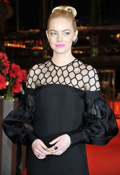 Emma Stone's accessories at The Croods Berlin premiere. Her stunning Gucci dress was complemented by floral jewels from designer Jamie Wolf.