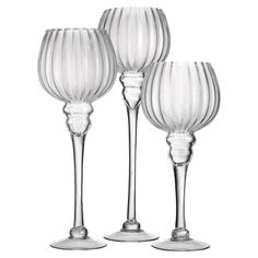 Equally at home on your coffee table or mantel, these sleek glass candleholders showcase slender silhouettes and fluted detailing for elegant appeal.