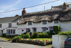 I adore the thatched cottages in Cornwall and Devon. This one is in Coverack.