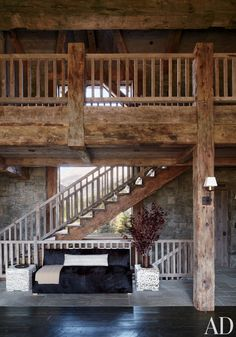 Rustic Staircase/Hallway by Markham Roberts Inc. and JLF & Associates Inc. in Big Sky, Montana