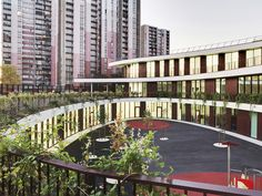 mikou design studio: bobigny school complex including nursery & school. Central courtyard & luscious creeping greenery