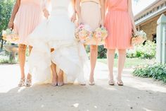 a sea of pink and peach dresses and #bouquets Photography: Marianne Wilson Photography - mariannewilson.net, Florals by http://kristineshindesigns.com  Read More: http://stylemepretty.com/2013/10/14/camarillo-wedding-from-marianne-wilson-photography/