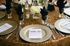 sparkly gold tablecloths and I like the thank you notes
