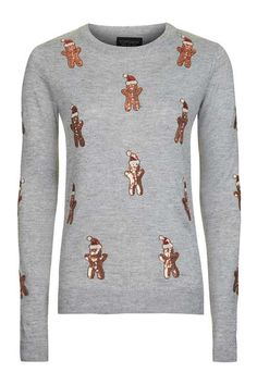 Get festive the fashion way in this super-cute Christmas jumper. In a boxy fit, this fine gauge knit also comes with a crew neck and all-over gingerbread man embellishment. #Topshop