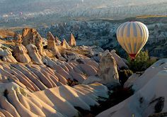 Cappadocia, Turkey has been rated one of the world's best spots for hot air ballooning. Check out these incredible photos of hot air balloons over Turkey. Cappadocia Balloon, Cappadocia Turkey, Istanbul Turkey, Kusadasi, Pamukkale, Places To Travel, Places To See, Travel Destinations, Amazing Destinations