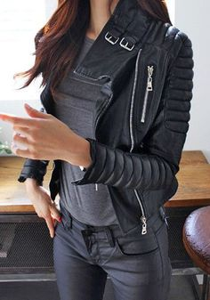 "Create a chic ""badass"" look in this black PU quilted biker jacket. It features padded shoulders and cool oblique zipper. 