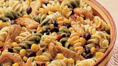 Lime juice and tequila in the dressing impart a tart kick to this colorful salad of rainbow rotini, corn and black beans.
