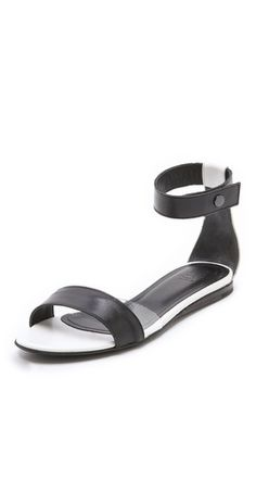 Tibi Brady Flat Sandals FREE SHIPPING at shopbop.com. Two-tone Tibi sandals add an easy spectator pop to any look. This chic pair has a futuristic touch of clear vinyl at the instep, and a snap strap affords a custom, adjustable fit. Smooth rubber sole. Leather: Calfskin. Made in Italy. This item cannot be gift-boxed. - White/Black
