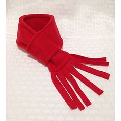 Red Dog Scarf, Christmas Dog Scarf, Fleece Dog Scarf.This handmade Furever Gracie Red Dog Scarf with fringe edge is made of soft, warm fleece and is available in 3 sizes. Easy to use and adjust to fit your dog's neck by pulling the fringe edge through the loop on the other end.