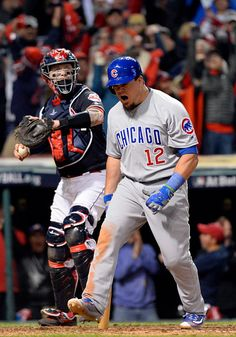 Kyle Schwarber of the Chicago Cubs reacts to striking out to end the top of the eighth inning during Game 1 of the 2016 World Series against the...