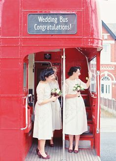 Bridesmaids on a double decker bus from a stylish 1940s inspired wedding