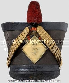 A shako for officers of the 5th Hussars Regiment, according to the regulation of 1810. Large, black felt body (crescent-shaped crack on the front). Adjustable head band and visor of black leather with tooled decoration.