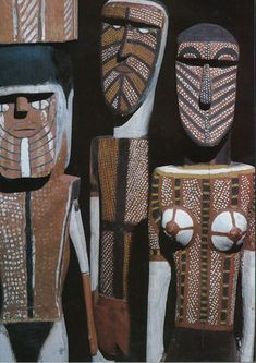 A group of carved and painted ironwood figures  associated with the Tiwi myth of Purukapali, Bathurst Island