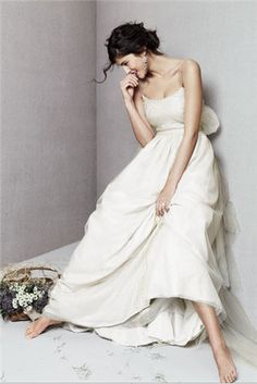 her dress style is softly lovely, not so formal she can't be comfortable being who she is.