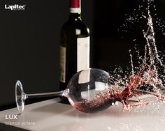 The only disaster is having to pour a new glass. Lapitec® Lux in Bianco Polare is stain proof and easy to clean.