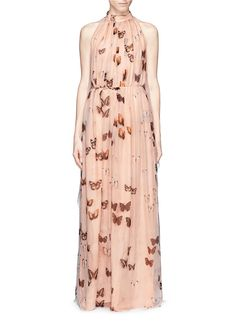 With a graphic so realistic that it looks like hundreds of butterflies sitting on your bare skin, this nude-tone silk chiffon gown from Givenchy captures the ethereal and effortless beauty in nature and you. The two sheer scarves that spread out from the back will sway as you move, just like the wings of the stunning creature.