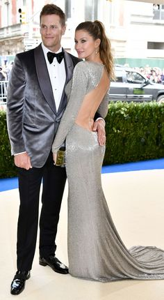 Gisele Bundchen worked it at the Met Gala in New York City on Monday night, dressed in a slinky silver gown and accompanied by her handsome football star husband, Tom Brady. Sabrina Sato, Tom Brady, Silver Dress, Gray Dress, Met Gala 2017 Dresses, Celebrity Dresses, Celebrity Style, Toms, Met Gala Red Carpet