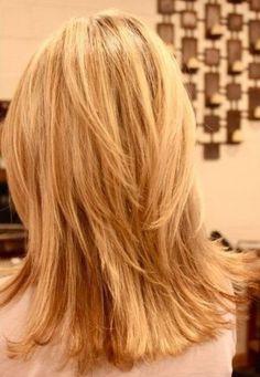 Layered mid length hair cut
