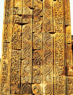 Carvings on the side of the Quwwat Ul-Islam arched screen. Though the decorative motifs here, such as the Arabic calligraphy and the depictions of plant life, are common features in Islamic buildings throughout the world, the very exuberant, dense, high relief, and somewhat less stylized, manner in which they have been rendered is unusual, and much more in-keeping with Hindu artistic sensibilities than with those more often associated with Islam. Mehrauli. Delhi