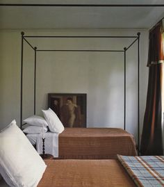 """Iron bed frame. Photo from book """"Tuscan Escapes"""" by Caroline Clifton Mogg."""