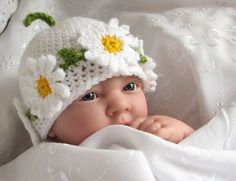 Crochet pattern for Daisy Chain hat in 4 sizes (pdf). $3.50, via Etsy.