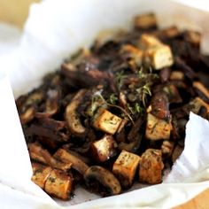 Mushrooms and tofu en papillote with miso, rosemary and balsamic vinegar. An elegant and delicious vegan main course.