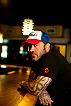 Aaron Lewis. The voice of an angel, magic finger on a guitar, bald, and covered in tattoos. He might just be the perfect man.