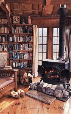 Cabin living room / library with wood-burning stove. Cozy Cabin, Cozy House, Small Log Cabin, Little Cabin, Log Cabin Homes, Log Cabins, Log Cabin Kitchens, Cabins And Cottages, Home Libraries