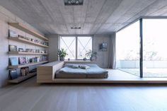 A simple yet spacious master bedroom opens upto a private terrace.