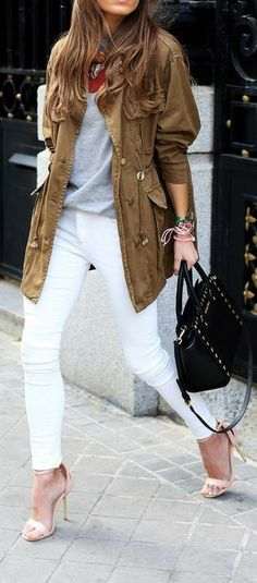 Grey sweater with brown stylish long jacket and white casual stylish plan jeans and black leather stylish hand bag and light pink high heels...