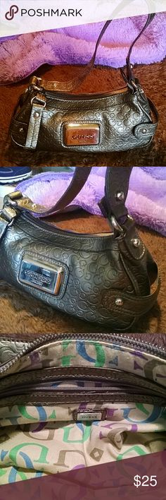 """Golden dream logo purse Gold 11"""" x 5""""""""x 4"""" shoulder bag with signature G. Inside is in great shape with green, blue, brown and purple signature G. Very cute and stylish. Guess Bags Mini Bags"""