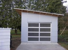 Prefab Studio garages: 14x or 16x foot (deep) structures with a framed opening for a one car garage door (sourced separately) on the 14x or 16x side. answers@studio-shed.com for more information