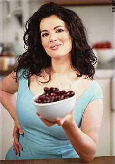 Nigella Lawson...if there were ever a testament to eating happily (meat, cheese, wine) into your older years, this woman is it.  Shes 53! Plus shes British, plus a chef, plus hot.