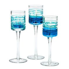 """SPRING SWIRLS VOTIVE TRIO  Item #:  P92297  A drizzle of azure blue adds a touch of springtime color to our popular stemmed holders. Glass trio for use with votives or tealights, sold separately. 7½"""", 7"""", 6½"""". Universal Tealight® CandleVotive $45.00/set of 3  http://www.partylite.biz/legacy/sites/kristianapflum/productcatalog?page=productdetail&name=Spring+Swirls+Votive+Trio&sku=P92297&categoryId=58877&showCrumbs=true"""