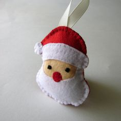 Felt christmas ornaments   santa clause by DusiCrafts on Etsy, $6.00 - Perfect to replace the Santa on my advent calendar