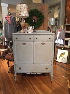 The finished chest in our custom Chalk Paint® colors! The body is in Chalk Paint® Coco & Louis Blue. The accent on the door & drawer insets in 1 Coco + 1 Louis + Chateau Grey! We then did a light wash on the edges in 2 Old White + 1 Paris Grey! Using Chalk Paint, Chalk Paint Colors, Paris Grey, Hand Painted Furniture, Annie Sloan, Drawer, Blue, Painting, Home Decor