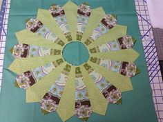 Got the template from this quilting magazine. Chose a flower on the fabric to be the top center of petal. Outlined it on the plastic templat...