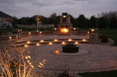 Outside patio with fireplace and lighting   by Culvers Garden