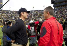 The Ohio State Buckeyes and Michigan Wolverines meet on the football field for the 112th time on Saturday in Columbus, Ohio.
