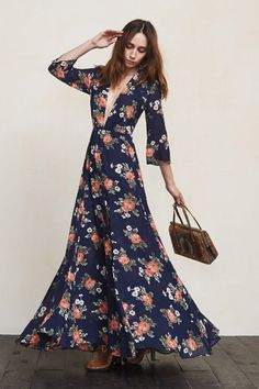 The Hall Dress really needs no introduction. Just look at her. This is a long sweeping gown with a plunging V neckline, sheer cropped sleeves and a front slit. The waist is fitted but the skirt allows plenty of room for dancing or just dramatically entering and exiting rooms.    https://www.thereformation.com/products/hall-dress-moon-shadow?utm_source=pinterest&utm_medium=organic&utm_campaign=PinterestOwnedPins