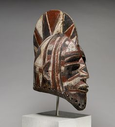 Africa | A helmet mask from the Bobo peoples of Burkina Faso.  ca. 19th - 20th century. Wood, paint, animal hair and resin | This genre of helmet mask, known as bolo (pl. bole), is worn by blacksmiths at important agricultural celebrations, initiation rites, and funerals in Bobo communities.