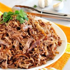 Juicy, moist Pork Carnitas with gorgeous golden brown crunchy bits! Incredibly easy, made in the slow cooker or oven. www.recipetineats.com