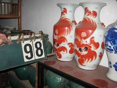 Pair of hand painted ceramic foo dog vases from Beijing, China