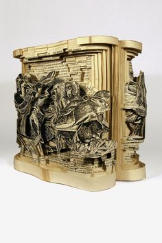 Insane art formed by carving books with surgical tools...