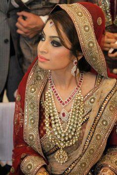 Traditional Indian Bride Wearing Bridal Saree Kundan Jewelery And Hairstyle