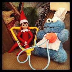 Dr. Elf: Instagram's lizbrownlee put her elf to work, giving some medical attention to Cookie Monster.